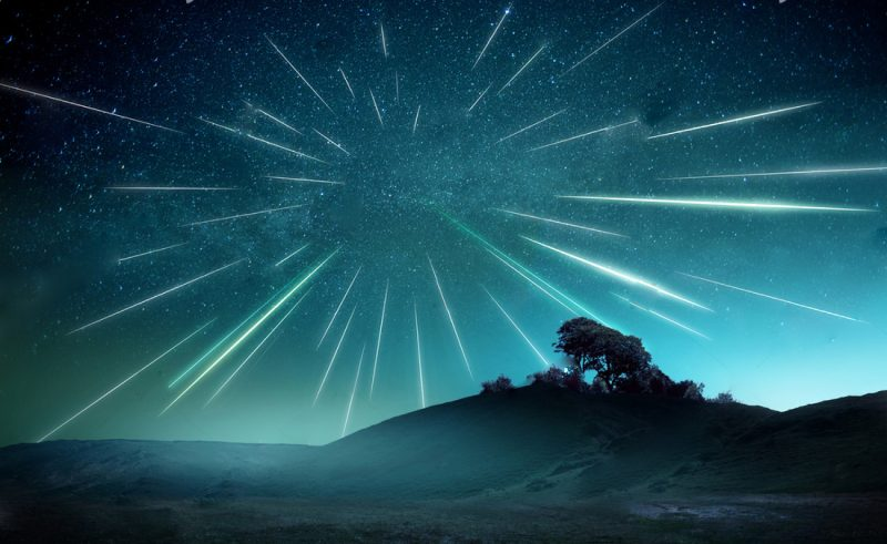 stock-photo-a-large-meteor-shower-on-a-misty-evening-with-streaks-across-the-sky-shooting-stars-landscape-1741231382